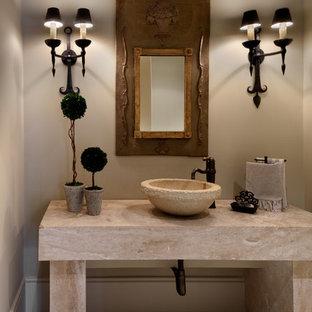 Идея дизайна: туалет среднего размера в средиземноморском стиле с настольной раковиной, бежевыми стенами, бежевой плиткой, полом из травертина и бежевой столешницей