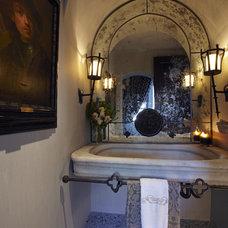 Mediterranean Powder Room by Carson Poetzl, Inc.