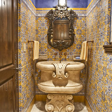 Mediterranean Powder Room by Chandos Interiors