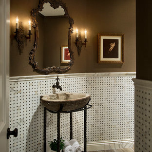 This is an example of a mid-sized mediterranean powder room in Phoenix with open cabinets, ceramic floors, brown walls and a vessel sink.