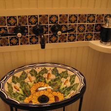 Mediterranean Powder Room by Geneva Cabinet Company
