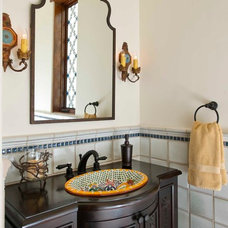 Mediterranean Powder Room by Phillip Jennings Custom Homes