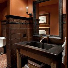 Mediterranean Powder Room by La Casa Builders Inc.
