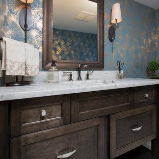 Idées déco pour un petit WC et toilettes classique avec un placard avec porte à panneau encastré, des portes de placard en bois sombre, un carrelage blanc, un mur bleu, un sol en carrelage de terre cuite, un plan de toilette en quartz modifié et un lavabo encastré.
