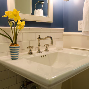 Example of a small classic white tile and ceramic tile powder room design in Seattle with a pedestal sink