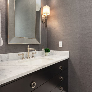 Design ideas for a small nautical cloakroom in Seattle with freestanding cabinets, brown cabinets, a one-piece toilet, white tiles, marble tiles, brown walls, marble flooring, a submerged sink, marble worktops, yellow floors and white worktops.