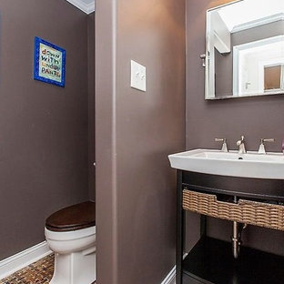 This is an example of a small modern cloakroom in Philadelphia with open cabinets, dark wood cabinets, a two-piece toilet, brown walls, slate flooring, a built-in sink and multi-coloured floors.