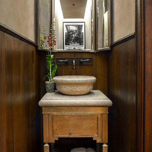 Transitional powder room photo in Denver with a vessel sink and furniture-like cabinets