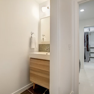 Design ideas for a medium sized midcentury cloakroom in Grand Rapids with flat-panel cabinets, light wood cabinets, white walls, slate flooring, an integrated sink, quartz worktops and grey floors.