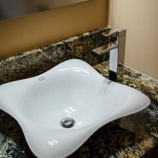 This is an example of a small retro cloakroom in Philadelphia with a vessel sink, flat-panel cabinets, medium wood cabinets, marble worktops, a one-piece toilet, multi-coloured tiles, stone tiles, beige walls and medium hardwood flooring.