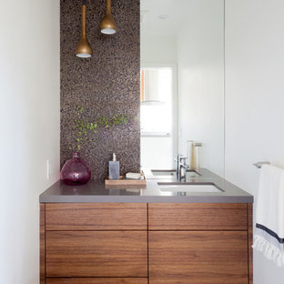Small contemporary powder room in Los Angeles with porcelain floors and black floor.