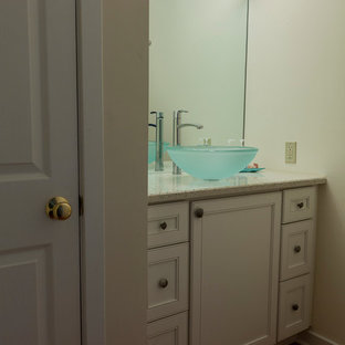 Photo of a small classic cloakroom in Bridgeport with flat-panel cabinets, white cabinets, a two-piece toilet, white walls, porcelain flooring, a vessel sink and recycled glass worktops.