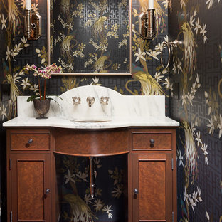Example of a classic mosaic tile floor and black floor powder room design in Minneapolis with recessed-panel cabinets, dark wood cabinets, multicolored walls, an undermount sink and white countertops