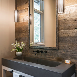 Powder room - large cottage powder room idea in Charlotte with white cabinets, concrete countertops, open cabinets, an integrated sink and gray countertops
