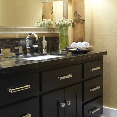 Powder room - transitional powder room idea in San Francisco with an undermount sink, shaker cabinets, black cabinets, marble countertops and black countertops