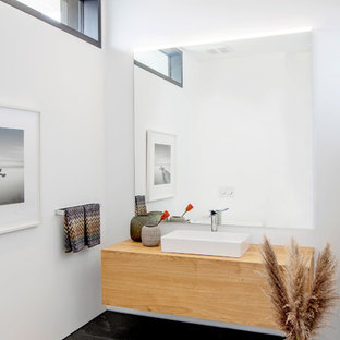 Large contemporary cloakroom in Vancouver with flat-panel cabinets, light wood cabinets, white walls, slate flooring, a vessel sink, wooden worktops and multi-coloured floors.