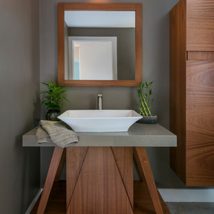 Design ideas for a small world-inspired cloakroom in Boston with flat-panel cabinets, dark wood cabinets, a one-piece toilet, grey walls, slate flooring, a vessel sink, limestone worktops, grey floors and grey worktops.