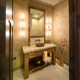 ダラスのラスティックスタイルのおしゃれなトイレ・洗面所 (ベッセル式洗面器、家具調キャビネット、中間色木目調キャビネット、ベージュの壁、ベージュの床、グレーの洗面カウンター) の写真