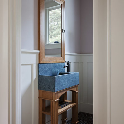 Powder room - mid-sized craftsman multicolored floor powder room idea in San Francisco with purple walls and a console sink
