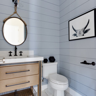 Rural cloakroom in Salt Lake City with freestanding cabinets, light wood cabinets, a two-piece toilet, grey walls, a submerged sink, white floors, white worktops and quartz worktops.