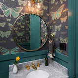Powder room - transitional powder room idea in Austin with multicolored walls, an undermount sink and marble countertops
