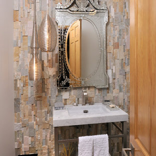 Photo of a rustic cloakroom in Charlotte with multi-coloured tiles, stone tiles and an integrated sink.