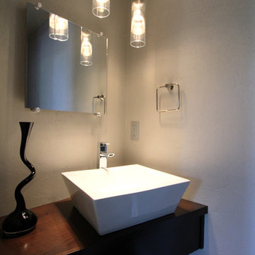 Modern powder bathroom with floating cabinet + vessel sink