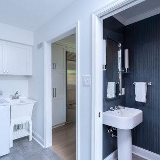 フィラデルフィアの小さいモダンスタイルのおしゃれなトイレ・洗面所 (白いキャビネット、青い壁、セラミックタイルの床、ペデスタルシンク、グレーの床、白い洗面カウンター、格子天井、壁紙) の写真