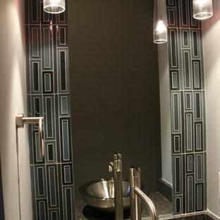 На фото: маленький туалет в стиле модернизм с синей плиткой, стеклянной плиткой, серыми стенами, настольной раковиной и столешницей из гранита с