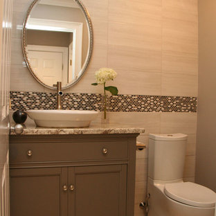 ボストンの小さいコンテンポラリースタイルのおしゃれなトイレ・洗面所 (ベッセル式洗面器、インセット扉のキャビネット、グレーのキャビネット、御影石の洗面台、分離型トイレ、グレーのタイル、ベージュのタイル、セラミックタイル、ベージュの壁、セラミックタイルの床) の写真