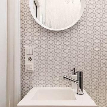 Modern white powder room with hexagon mosaic