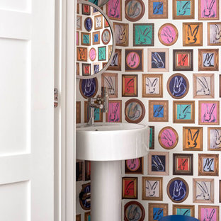 Eclectic blue floor powder room photo in Minneapolis with multicolored walls and a pedestal sink