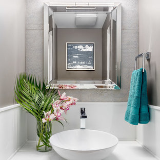 Small classic cloakroom in Vancouver with flat-panel cabinets, white cabinets, a two-piece toilet, multi-coloured tiles, porcelain tiles, grey walls, medium hardwood flooring, a vessel sink and quartz worktops.