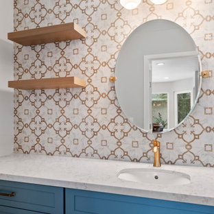 Inspiration for a medium sized coastal cloakroom in Orange County with shaker cabinets, blue cabinets, multi-coloured tiles, porcelain tiles, grey walls, vinyl flooring, a submerged sink, engineered stone worktops, brown floors, multi-coloured worktops and a built in vanity unit.