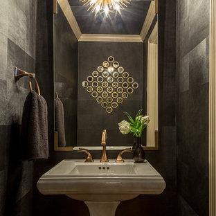 На фото: маленькие туалеты в стиле модернизм с фасадами островного типа, унитазом-моноблоком, серыми стенами, светлым паркетным полом, раковиной с пьедесталом и коричневым полом