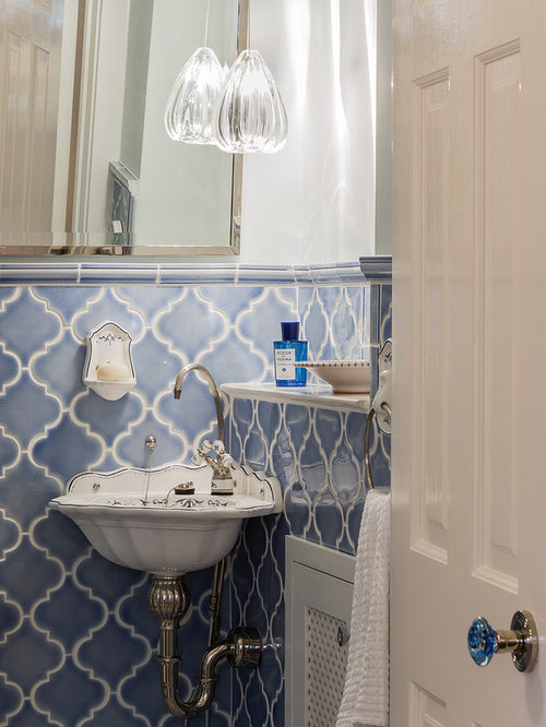small ornate blue tile and ceramic tile powder room photo in boston with white walls and