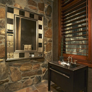 Example of a trendy powder room design in Charleston with an integrated sink