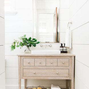 Inspiration for a traditional cloakroom in Salt Lake City with white walls, cement flooring, multi-coloured floors, freestanding cabinets, light wood cabinets, a vessel sink, wooden worktops and beige worktops.
