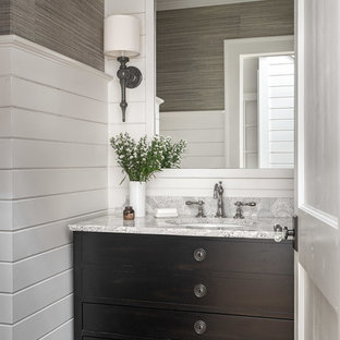 Powder room - mid-sized beach style medium tone wood floor powder room idea in Atlanta with engineered quartz countertops, furniture-like cabinets, brown cabinets, multicolored walls, an undermount sink and gray countertops