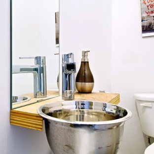 Urban powder room photo in Toronto with wood countertops, a drop-in sink and brown countertops