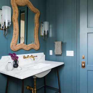 Inspiration for a coastal gray floor powder room remodel in Chicago with blue walls and an undermount sink