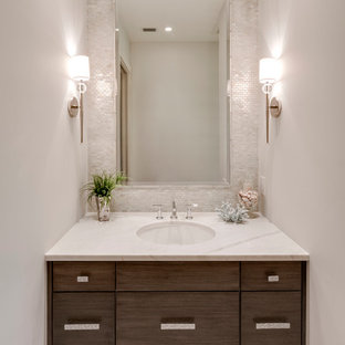 This is an example of a beach style cloakroom in Miami with a submerged sink, flat-panel cabinets, dark wood cabinets, engineered stone worktops, grey tiles, mosaic tiles and white walls.