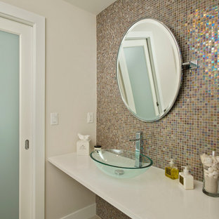 Photo of a small contemporary cloakroom in Miami with a vessel sink, engineered stone worktops, multi-coloured tiles, mosaic tiles, beige walls, ceramic flooring and white worktops.