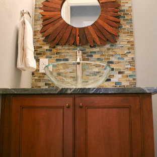 Design ideas for a modern cloakroom in Austin with recessed-panel cabinets, medium wood cabinets, multi-coloured tiles, glass tiles, grey walls, a vessel sink and soapstone worktops.