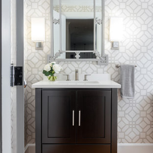 Powder room - mid-sized transitional medium tone wood floor and brown floor powder room idea in Boston with black cabinets, gray walls, an undermount sink, white countertops, furniture-like cabinets and quartz countertops