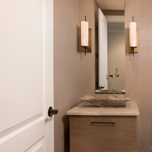 Inspiration for a small classic cloakroom in Boston with flat-panel cabinets, medium wood cabinets, beige walls, slate flooring, a vessel sink, limestone worktops and brown floors.