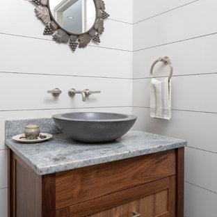 На фото: маленькие туалеты в стиле кантри с фасадами островного типа, коричневыми фасадами, белыми стенами, настольной раковиной, столешницей из гранита и синей столешницей