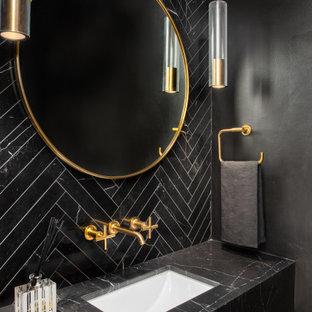 ワシントンD.C.のコンテンポラリースタイルのおしゃれなトイレ・洗面所 (黒いキャビネット、黒いタイル、黒い壁、アンダーカウンター洗面器、フローティング洗面台) の写真