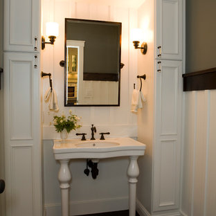 Example of an arts and crafts powder room design in Other with white cabinets and a console sink