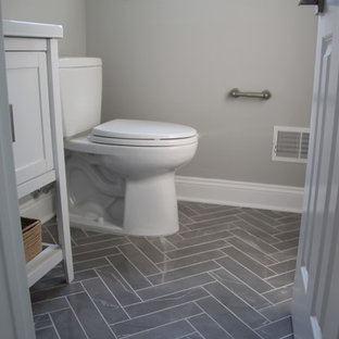 Powder room - small transitional marble floor and gray floor powder room idea in New York with shaker cabinets, white cabinets, a two-piece toilet, gray walls, an undermount sink and quartz countertops